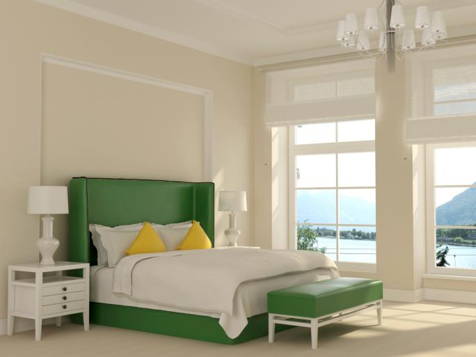 green-and-white-bedroom-with-chandelier