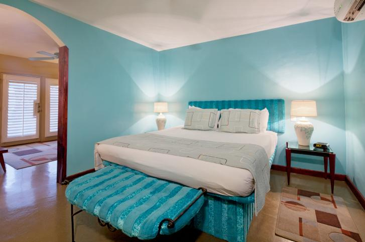 turquoise-bedroom-with-light-wood-flooring