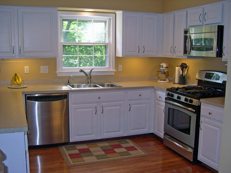 white painted oak kitchen cabinet remodeling idea