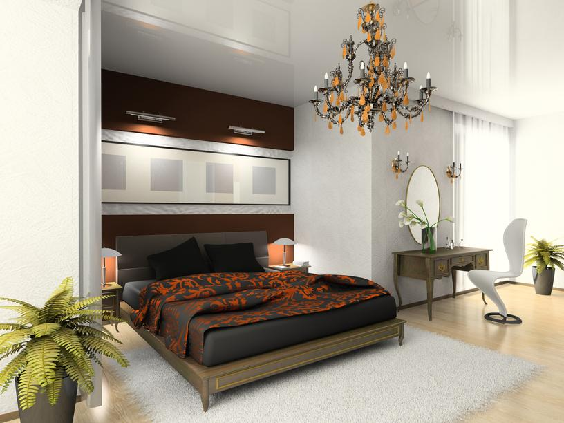 bedroom-with-light-wood-floor-and-white-walls