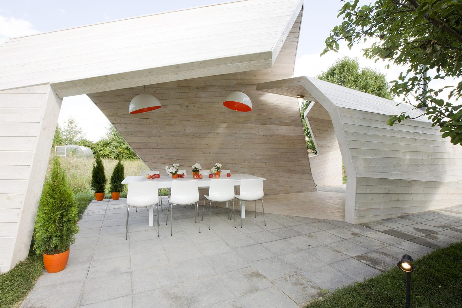 A stylish white gazebo made of wood