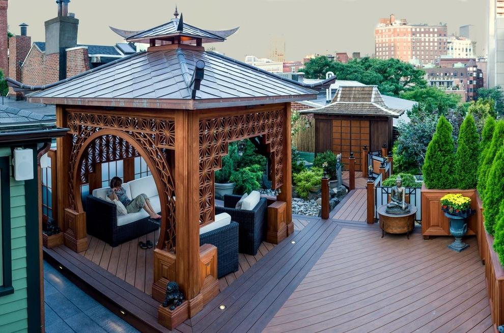 Gazebo in oriental style on the roof of the high-rise building