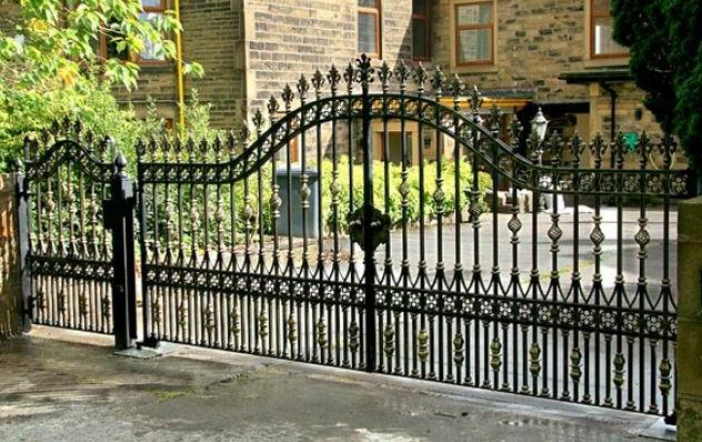 Beautiful forged gates with wicket