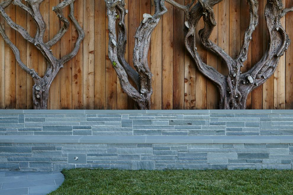 Combined fence of decorative stone and wooden fences