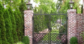 Forged gates perfectly combined with brick wall