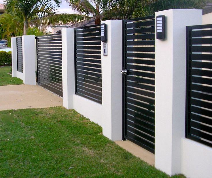 Modern metal fence with contrasting concrete pillars