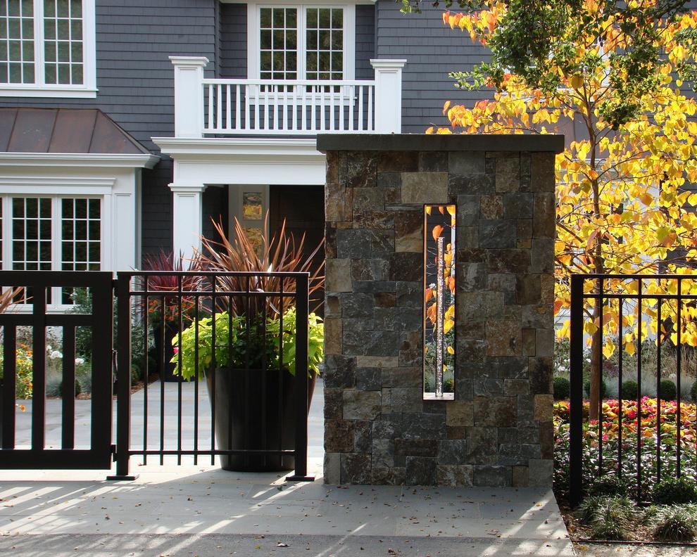 Modern metal fence with stone pillars