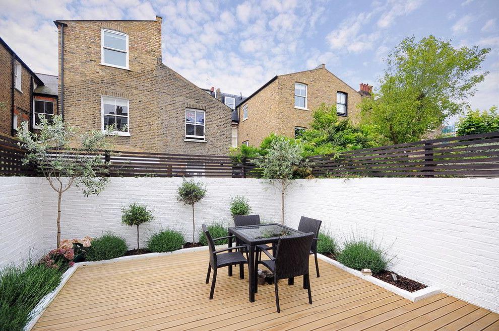 Painted white, the brick fence looks stylish