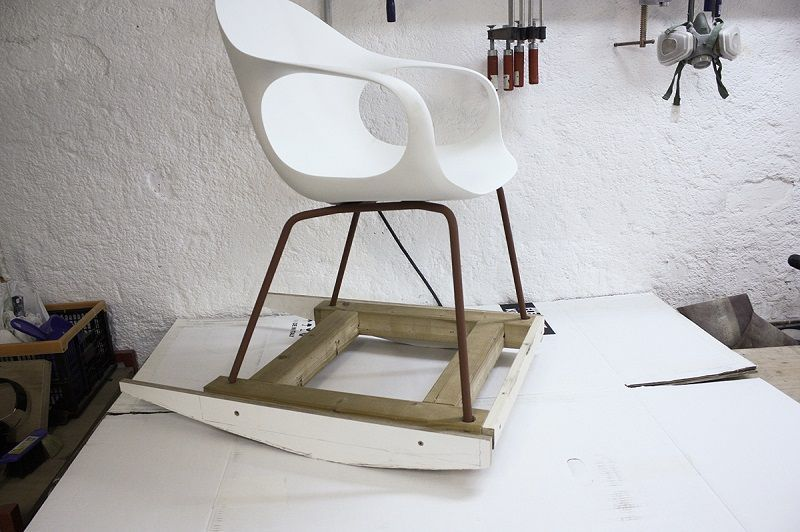A sample of a rocking chair from an ordinary chair and makeshift skids