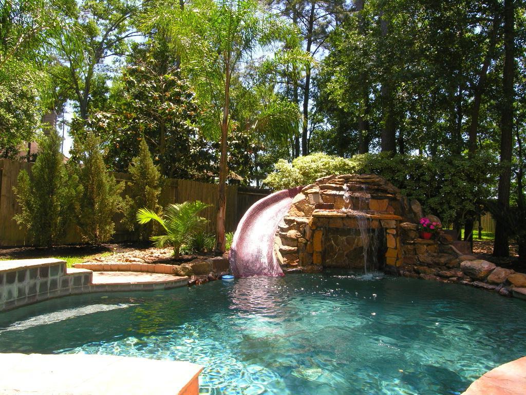 backyard pool design with waterfall slides