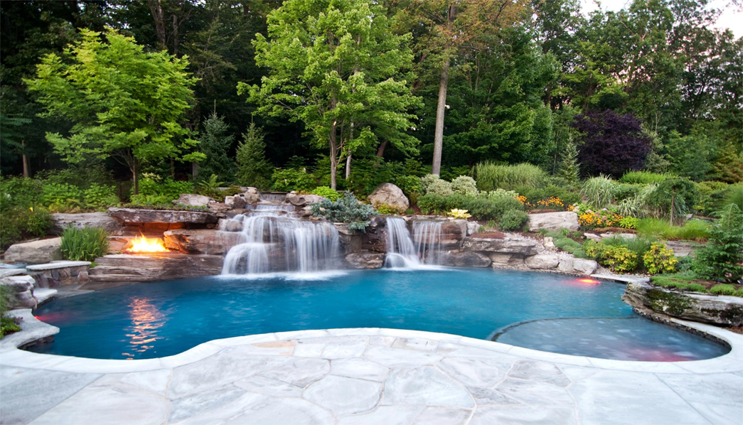 backyard pool with fire pit