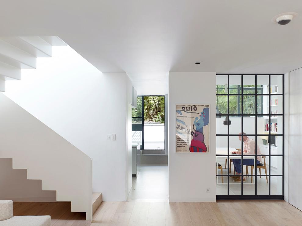 Built In Glass Wardrobes With White Staircase