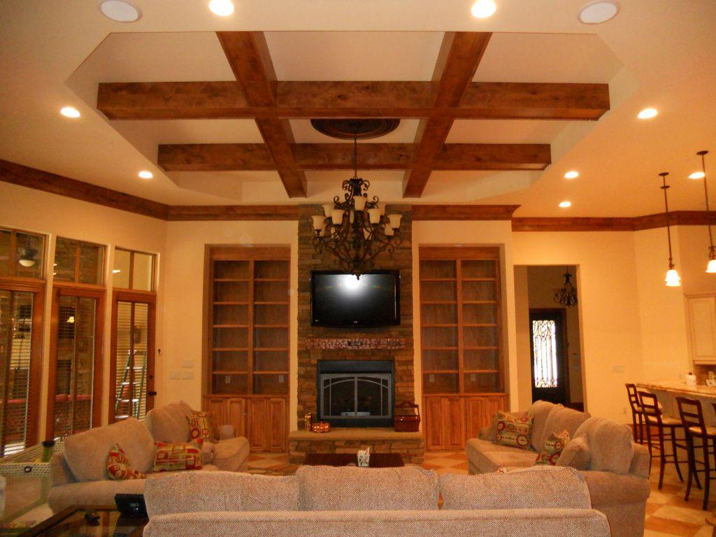 Stunning wooden beam ceiling design for living room feat black iron hanging lamp