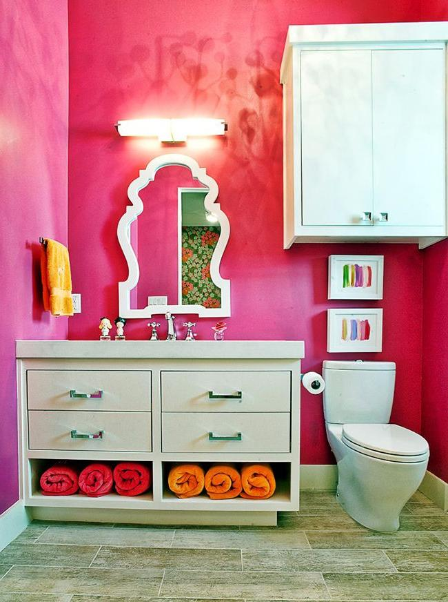 bathroom storage cabinet with colorful wall