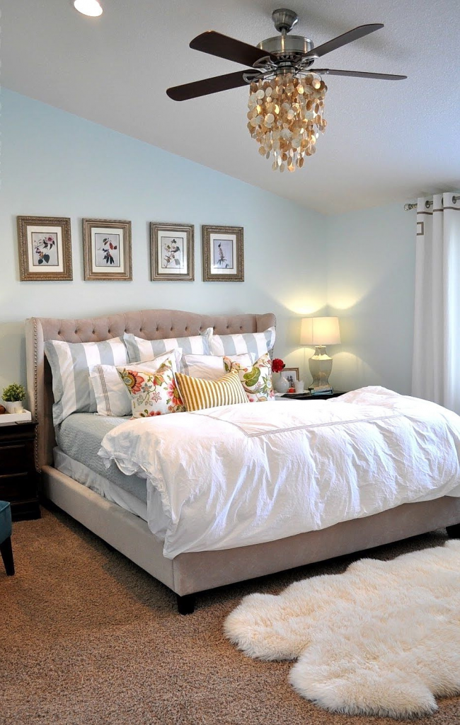 Chandelier with a fan in the bright bedroom