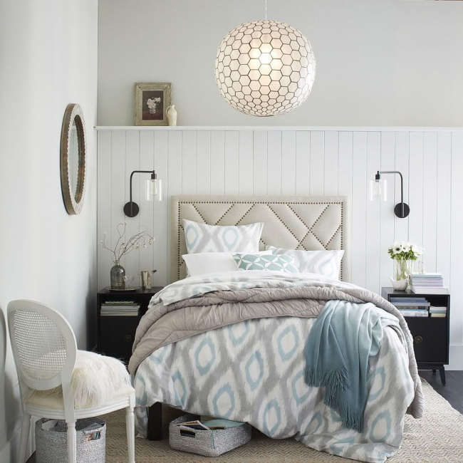 Modern chandelier in the bright bedroom