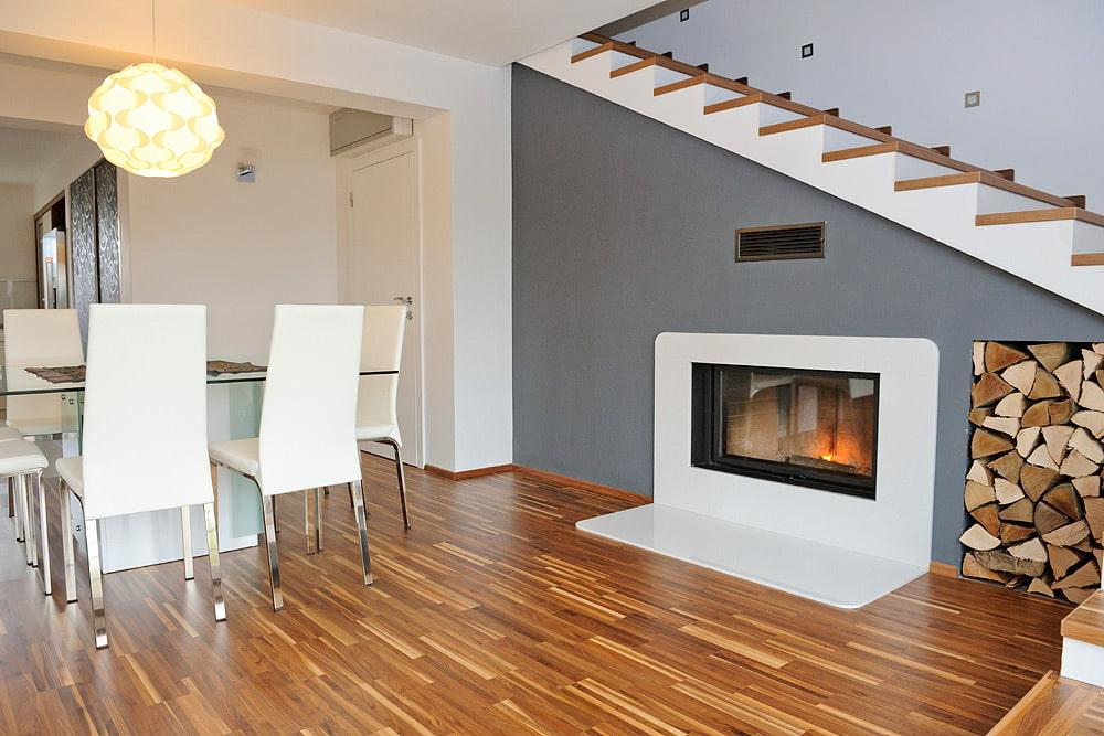 fireplace or stove under staircase