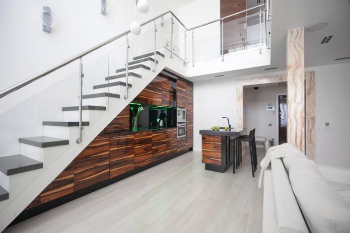 modern kitchen built into the flight of stairs