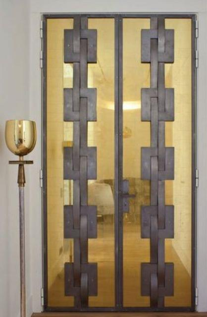 brass and grey modern front doors