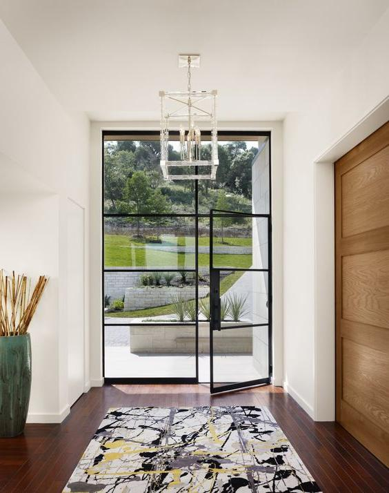 oversized blackened steel frame glass front door