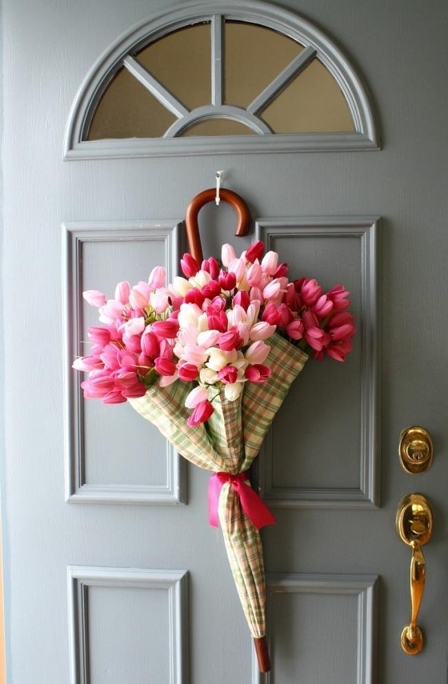 Spring door decoration with artificial tulips