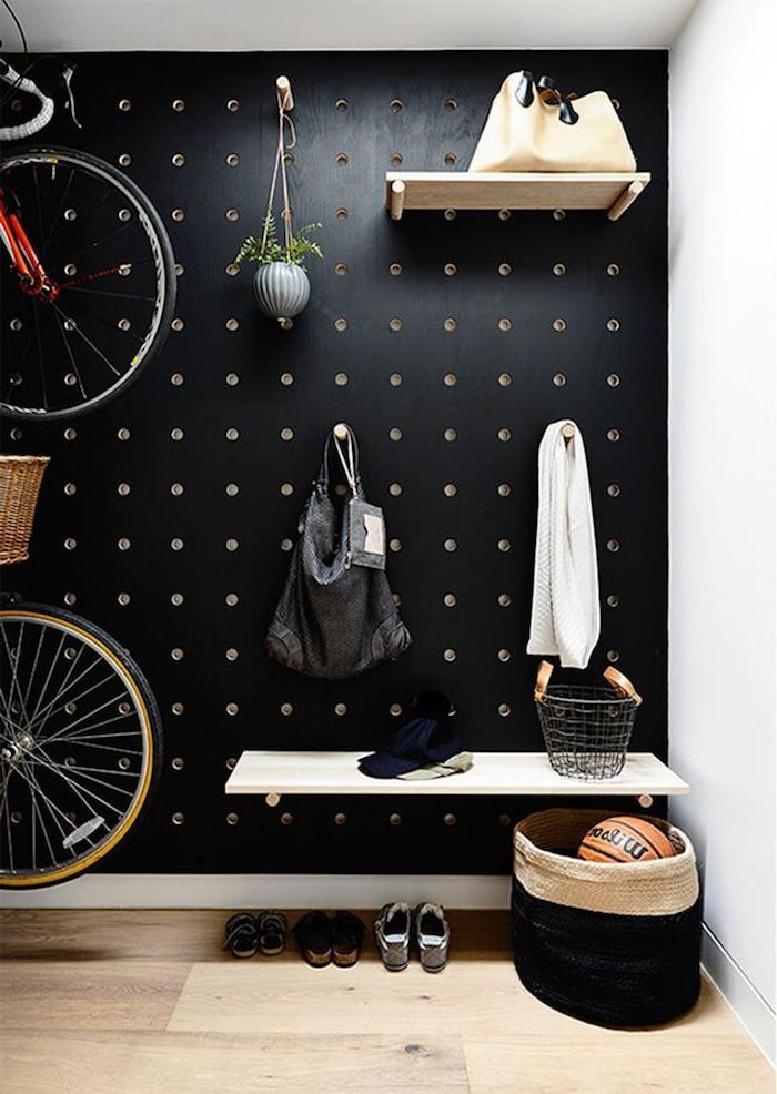 Functional perforated rack in the wall in the hallway