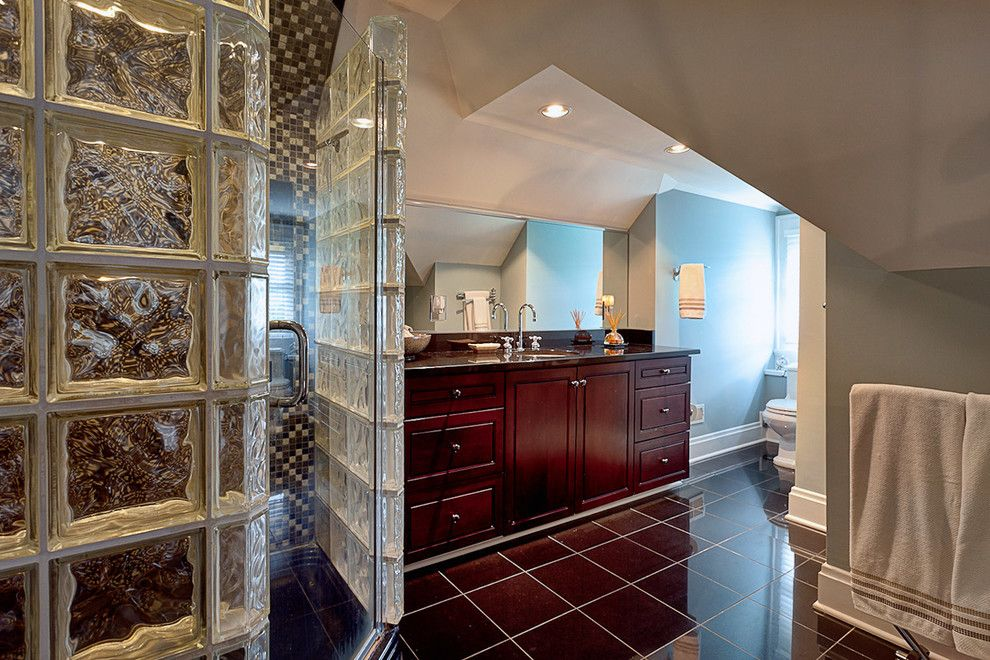 decorated with elegant partitions and a glass door.