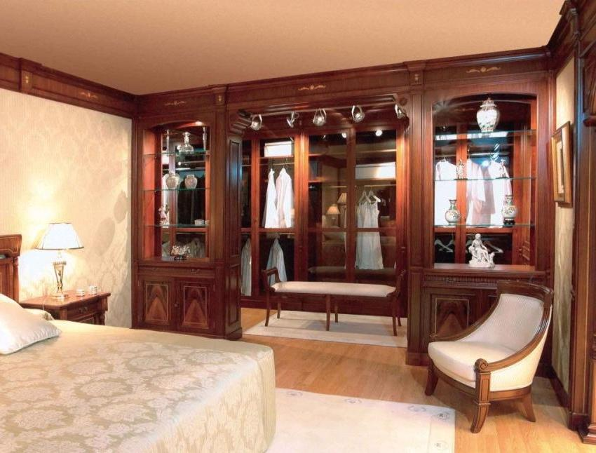 A dressing room is equipped along one of the bedroom walls.