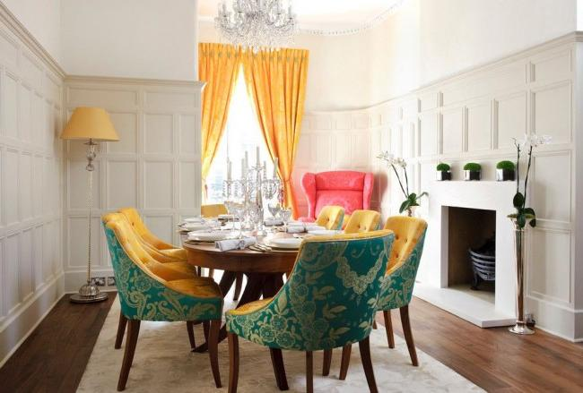 Bright curtains and massive chairs in the dining room