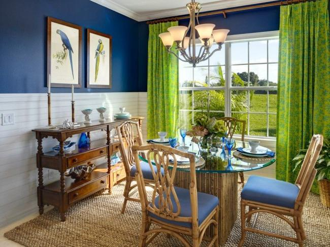 Bright dining room in tropical style with central lighting