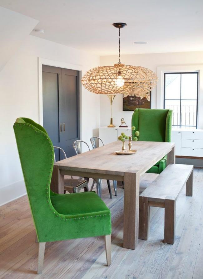 Contrasting green chairs and an unusual chandelier