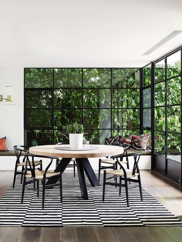 Dining area in a private house with large windows