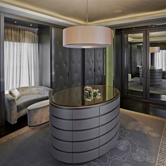Modern dressing room in gray tones with an island in the center.