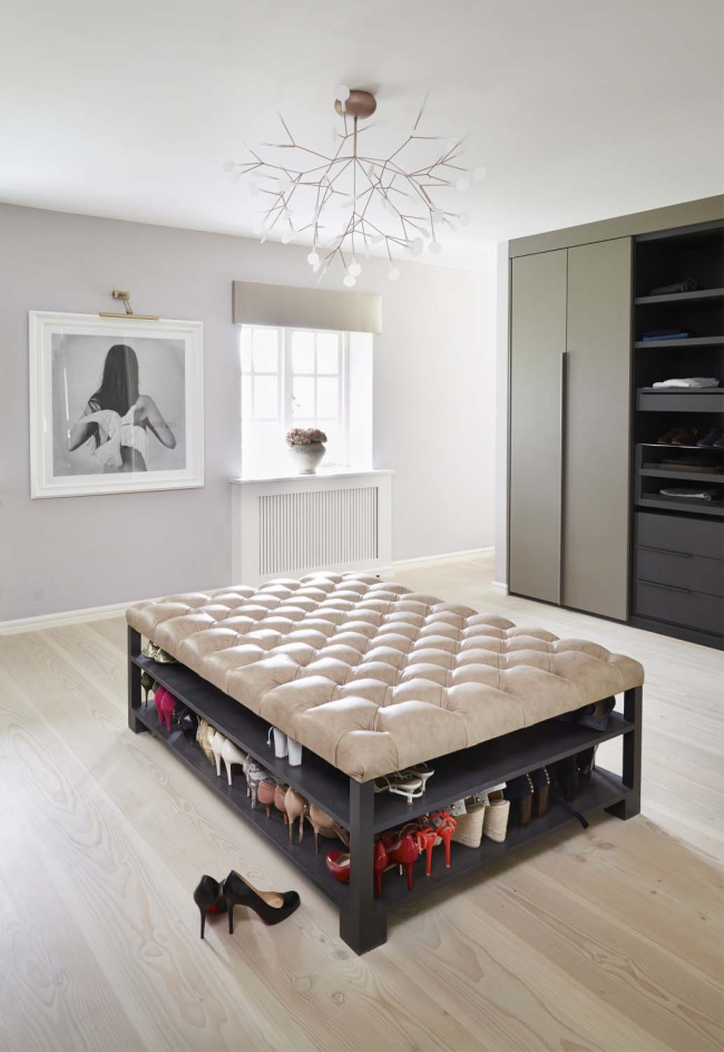 Modern dressing room with a large pouf in the center