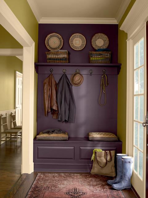 a small entrance hall with a closet for shoes with a comfortable seat