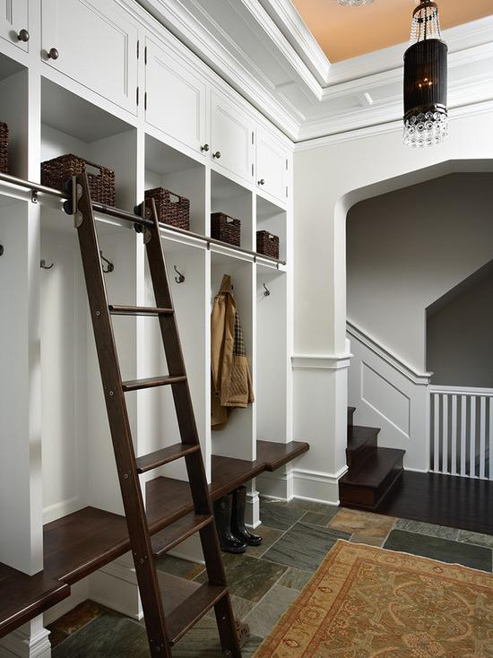 wardrobe with ladder for getting things from the upper mezzanine