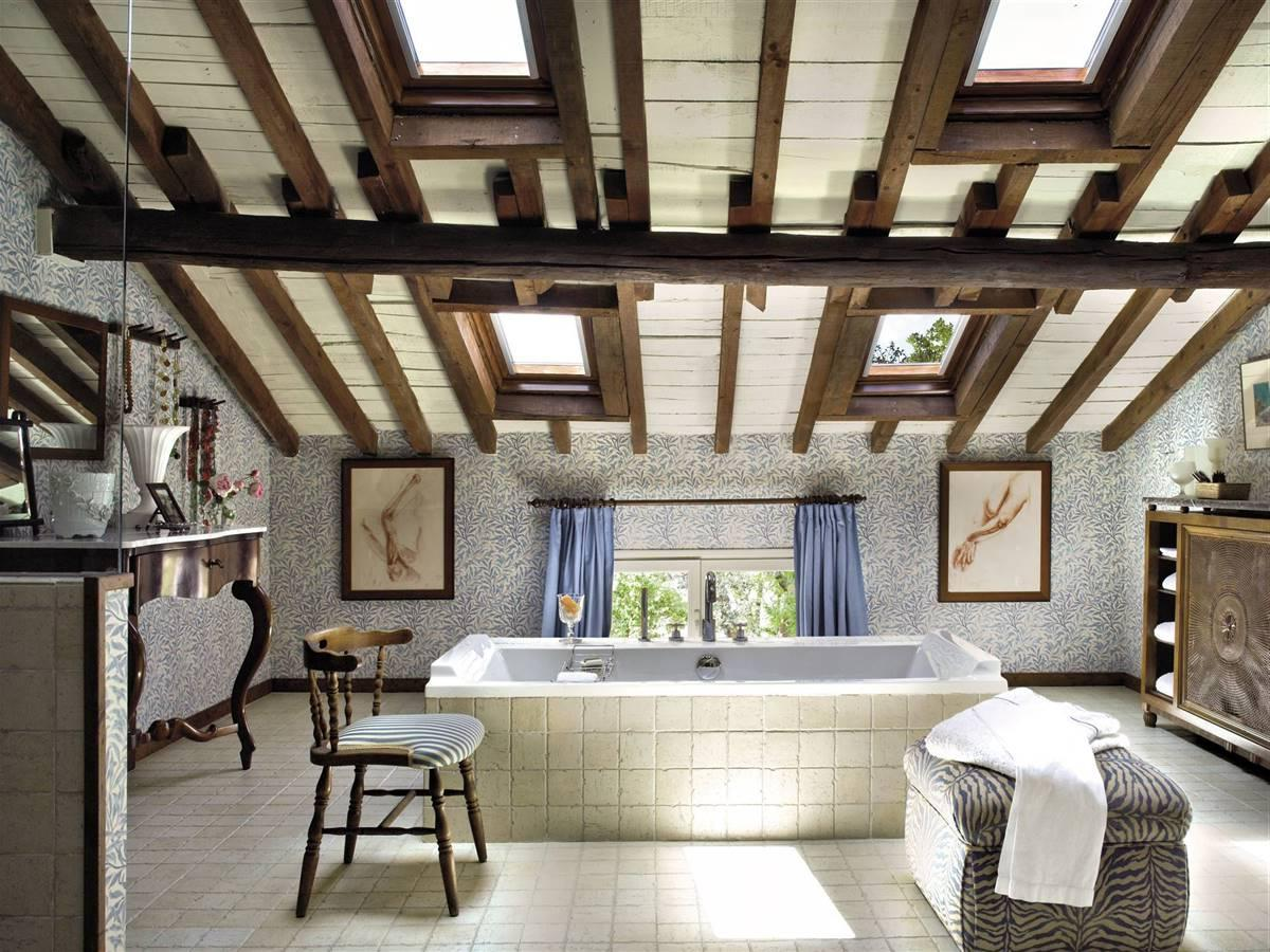 A RUSTIC BATHROOM WITH A FREESTANDING BATHTUB