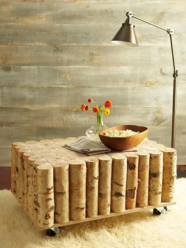 Coffee table on wheels made of logs