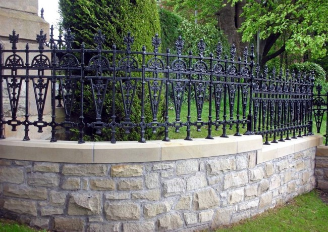 Fence with stone base and forged top