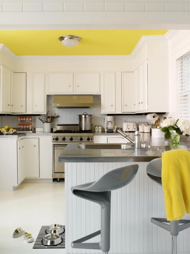 Lemon ceiling - a bright note in the interior of the kitchen