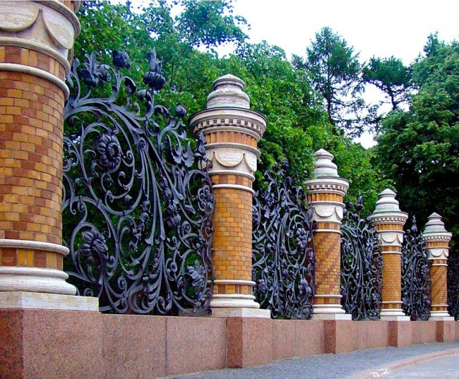 Luxurious, majestic forged fence with monumental brick supports