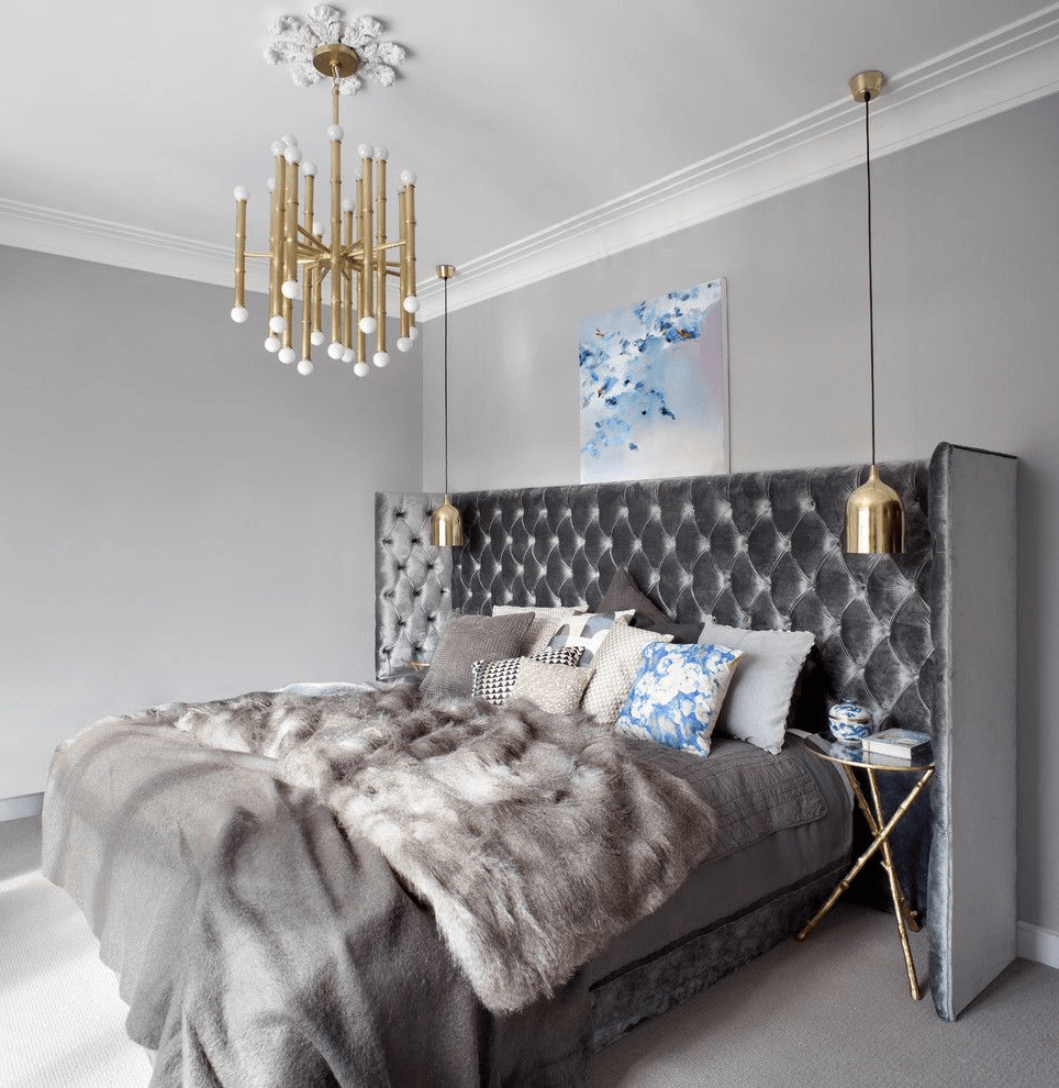 Stylish bedroom in gray colors with bedside ceiling lights
