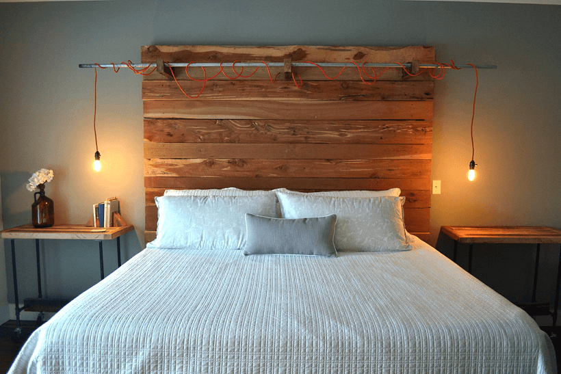 Unusual lamp mounted on the wooden headboard