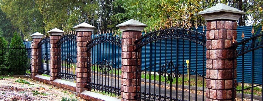 brick supports and forged rods create a pretty solid protective fence