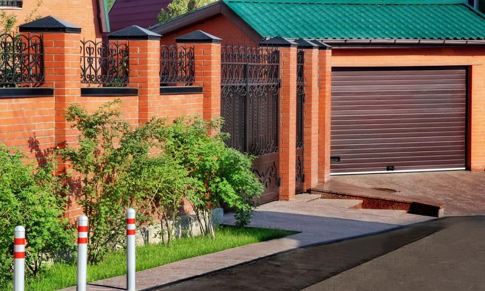 A decent combination of forged elements with red brick fencing styles