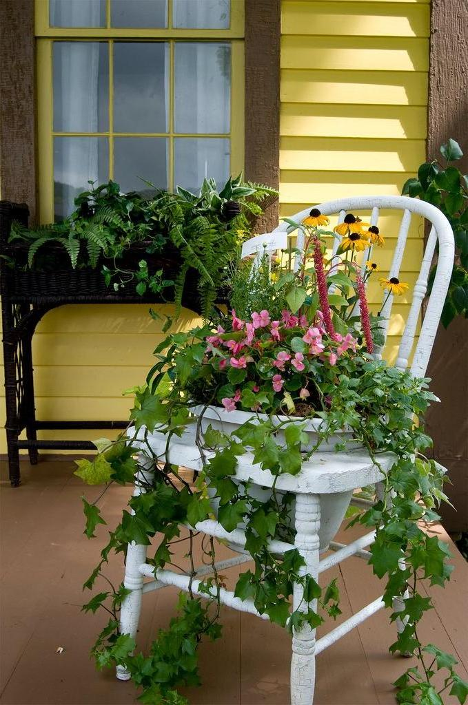 An old chair can be a great base for creating a floral arrangement.