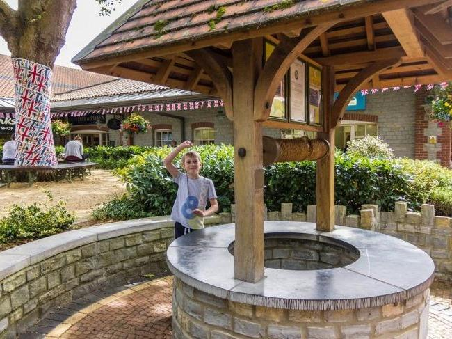 Beautiful well with a stone base and a tiled roof