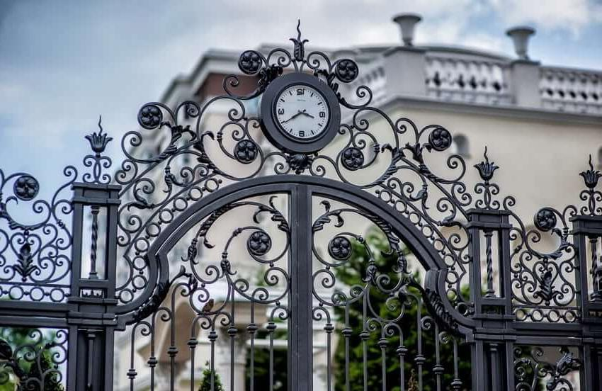 Forged fence with a clock - an interesting idea