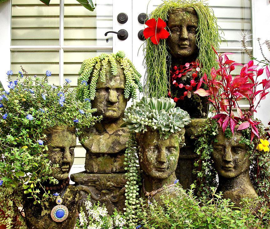 Funny pots in the form of concrete busts with plants-hairstyles will not leave you indifferent