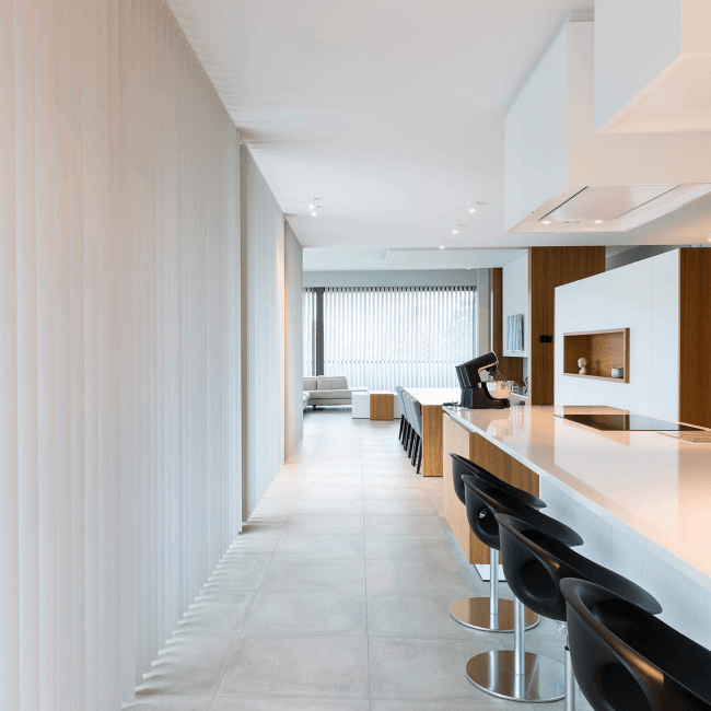 Minimalism in the interior of the kitchen, combined with the dining room